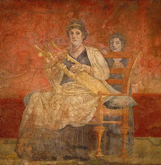 Una mujer interpretando la kithara