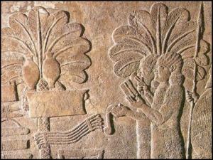 Relieve Asirio con detalle de elementos vegetales de la region.